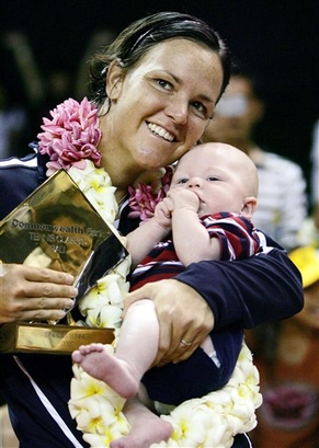 Lindsay Davenport of the USA holds her baby Jagger Jonathan Leach, 3 , after her victory over Daniela Hantuchova of sovlakia during a final match of the WTA Bali Open tennis tournament in Nusa Dua, Bali, Indonesia, Sunday, Sept 16, 2007. Davenport won 6-4,3-6, 6-2. (AP Photo/Achmad Ibrahim)